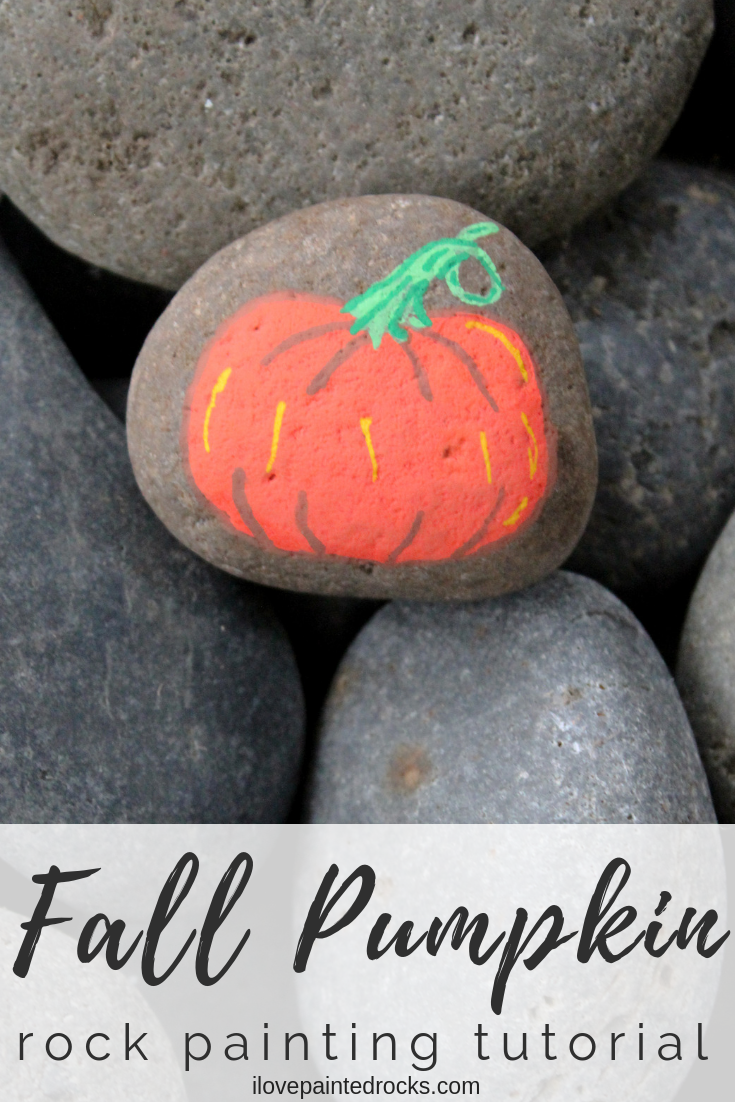 How to make a pumpkin painted rock. This is a super easy fall rock painting tutorial using Posca paint pens to draw a cute pumpkin. #ilovepaintedrocks #rockpainting #paintedrocks #rockart #stoneart #posca #rockpaintingideas #kidscraft #painting #paintpens #fallcraft #easypainting #storystones