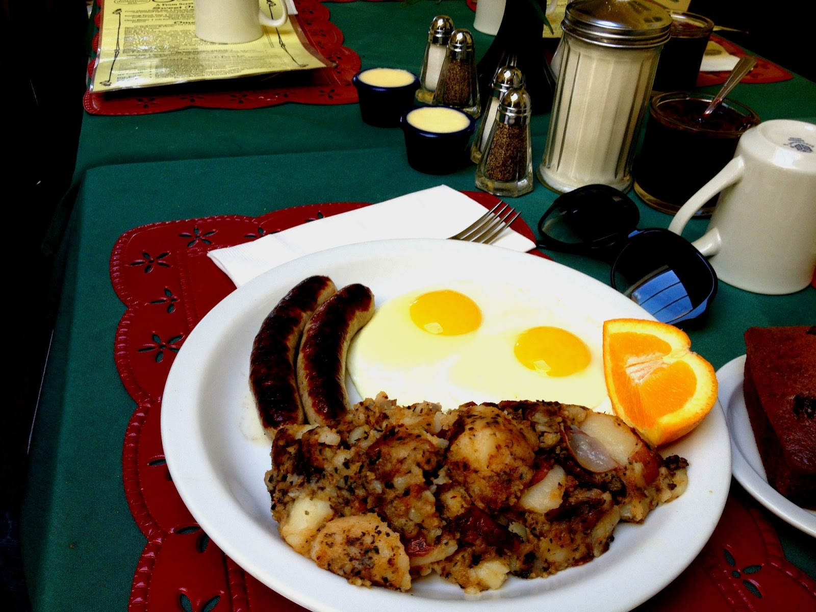 Sunny side up eggs, potatoes, sausages