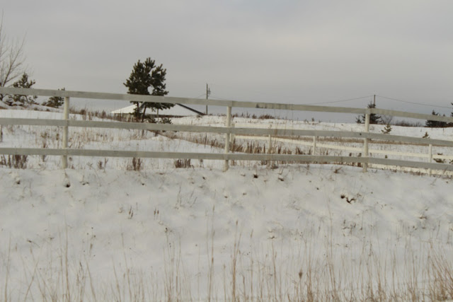 White fence, snowy field