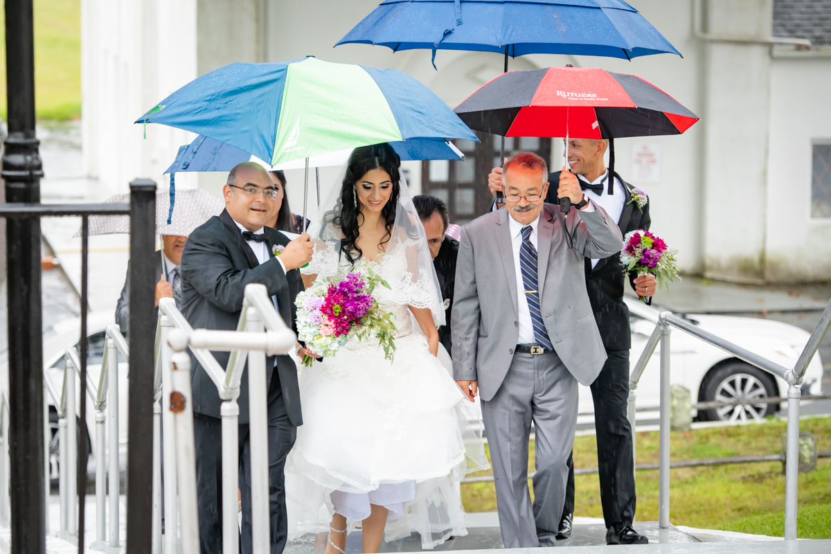 And the bride arrives despite the unfavorable weather conditions, this shows true love in action.