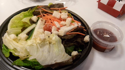 KFC's premium salad that costs Php 120, bigger serving plus additional croutons and- I think these are- turnips/singkamas.
