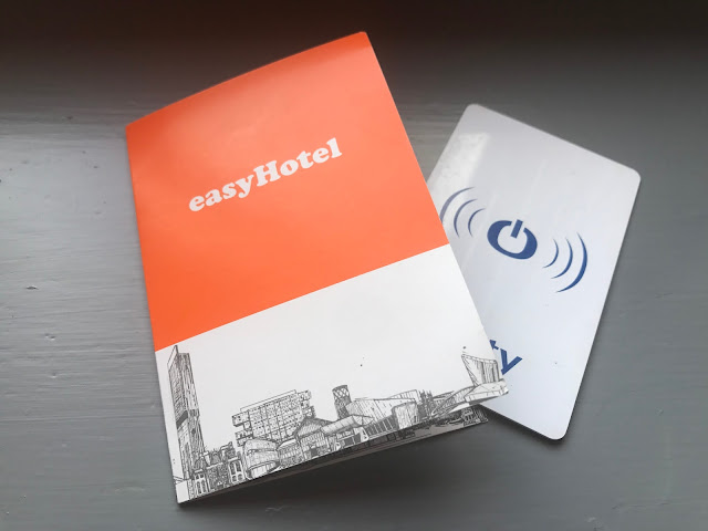 A hotel key card and a piece of cardboard with easyHotel on it