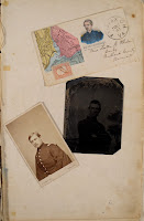 A pair of portrait photographs and a postcard.