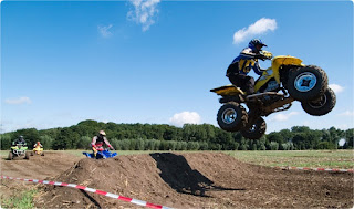 Quad bike getting air off a jump