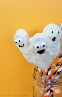 Adorable white chocolate covered  nutter butter ghosts! {www.prettyprovidence.com}