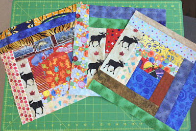 Slab blocks made with Stonehenge Oh Canada fabric by Northcott