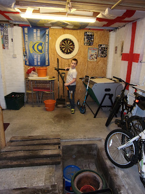 collection of gardening tools and dartboard