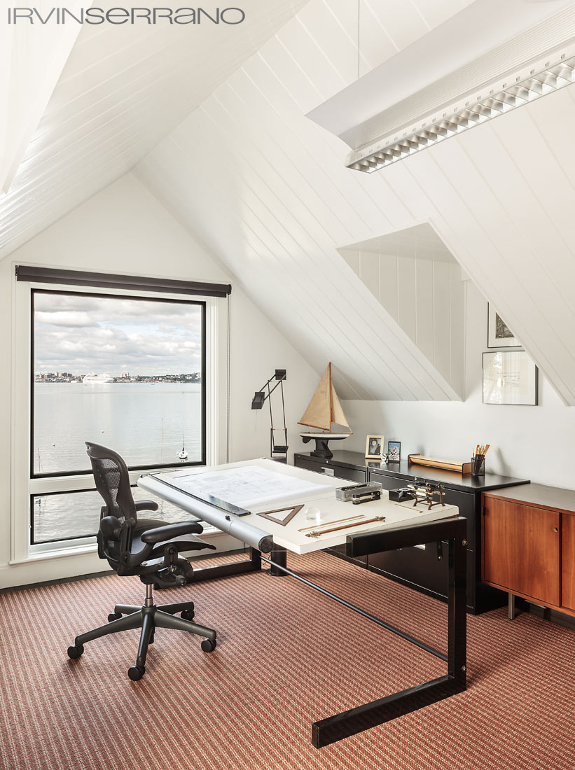 An architect's drafting table sits in a home office overlooking the Casco Bay on Peaks Island, Maine.