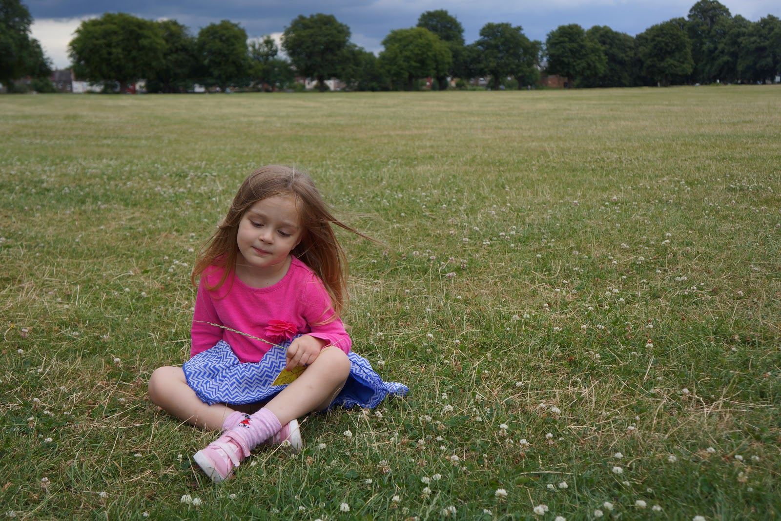 girl sitting on grass in park