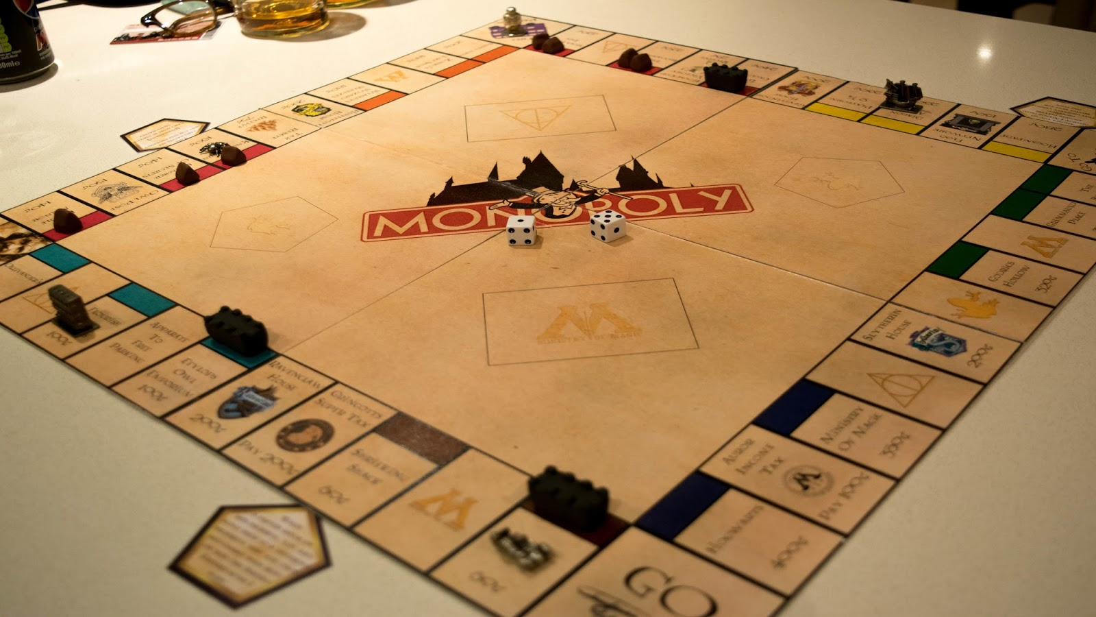Diy harry potter monopoly charlie lou btw im releasing my designs for free so if youre interested in making this exact board you can download the cards and board here solutioingenieria Gallery