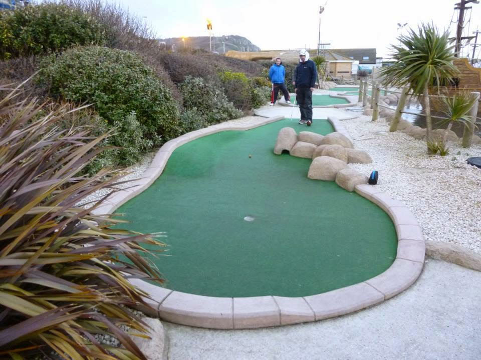 John Moore plays a shot down hole 14 of the Pirate Golf course at Hastings Adventure Golf