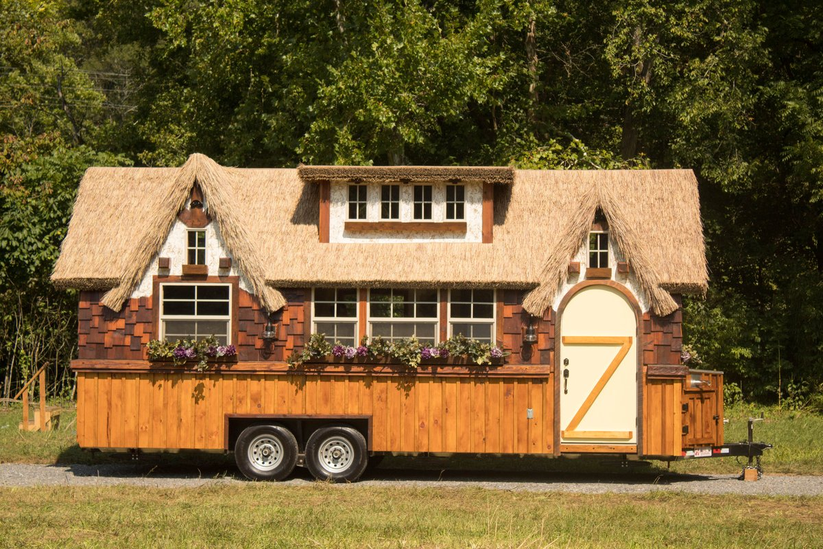 13-Exterior-View-The-Highland-Tiny-Home-on-wheels-with-Thatched-Roof-www-designstack-co