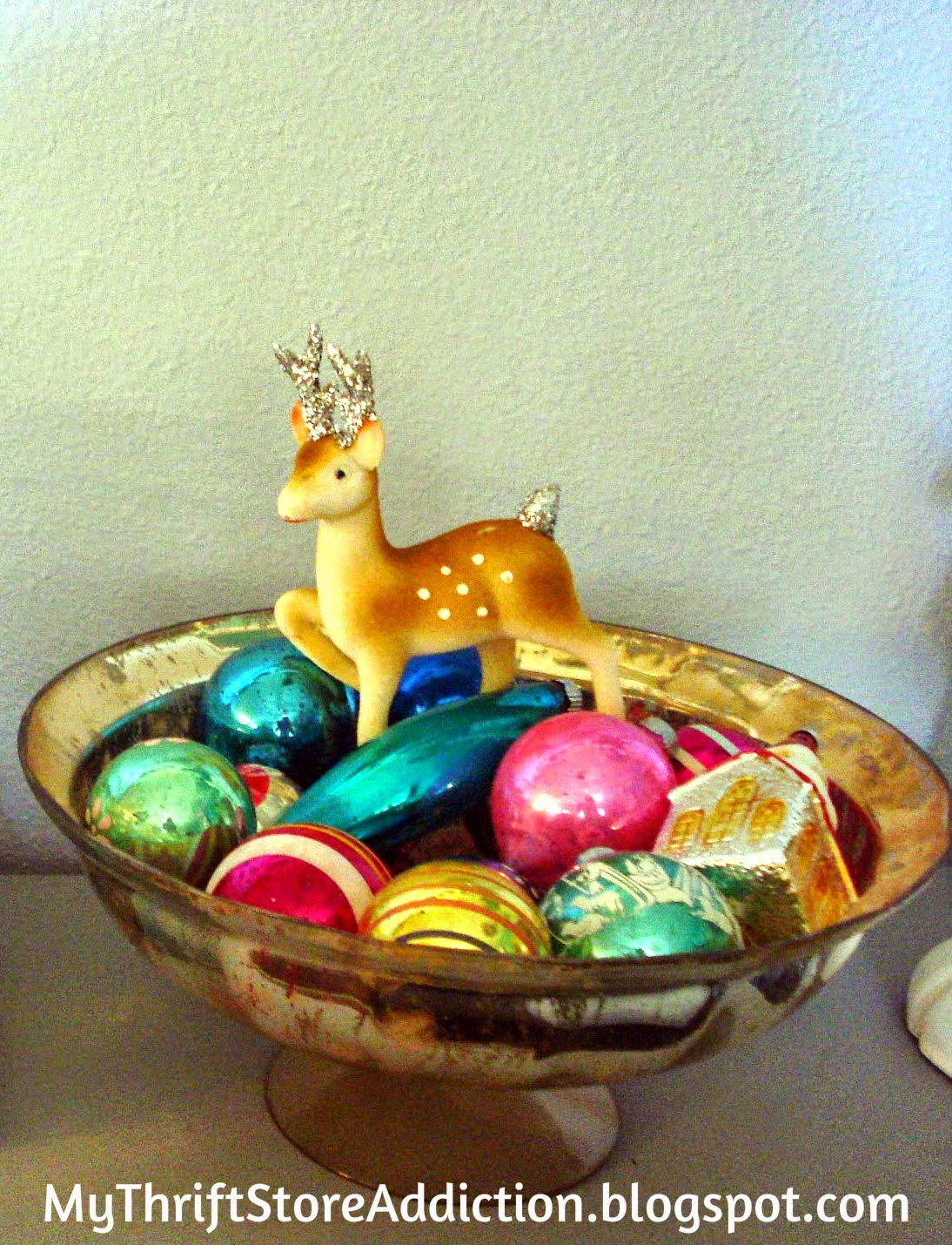 Mercury glass bowl of vintage ornaments