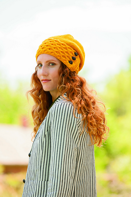 ... worsted-weigh hat with a honeycomb cabled brim that is knit flat e59d2561a29