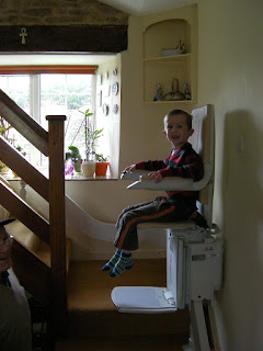 boy on a stairlift