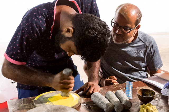 Kochi-Muziris Biennale: Laterite stones manually ground down provided one hue of yellow