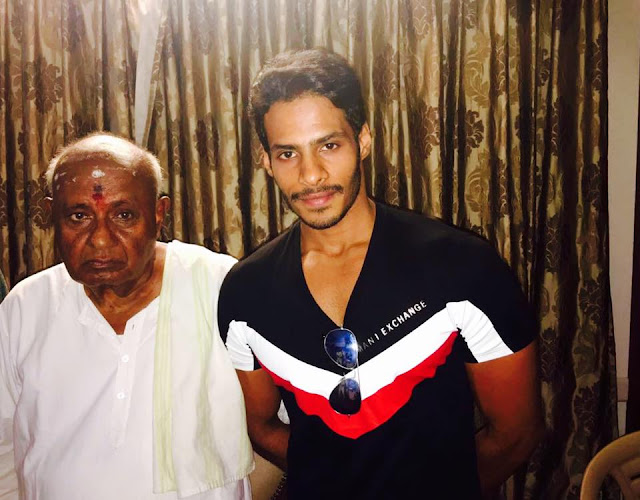 Nikhil Kumar with H D Deve gowda