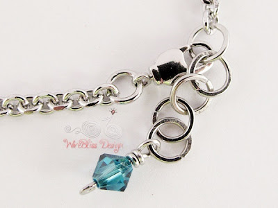 Close up of Wire Wrapped Minima Bracelet (Minlet) with 4mm Blue Swarovski Crystals Charm