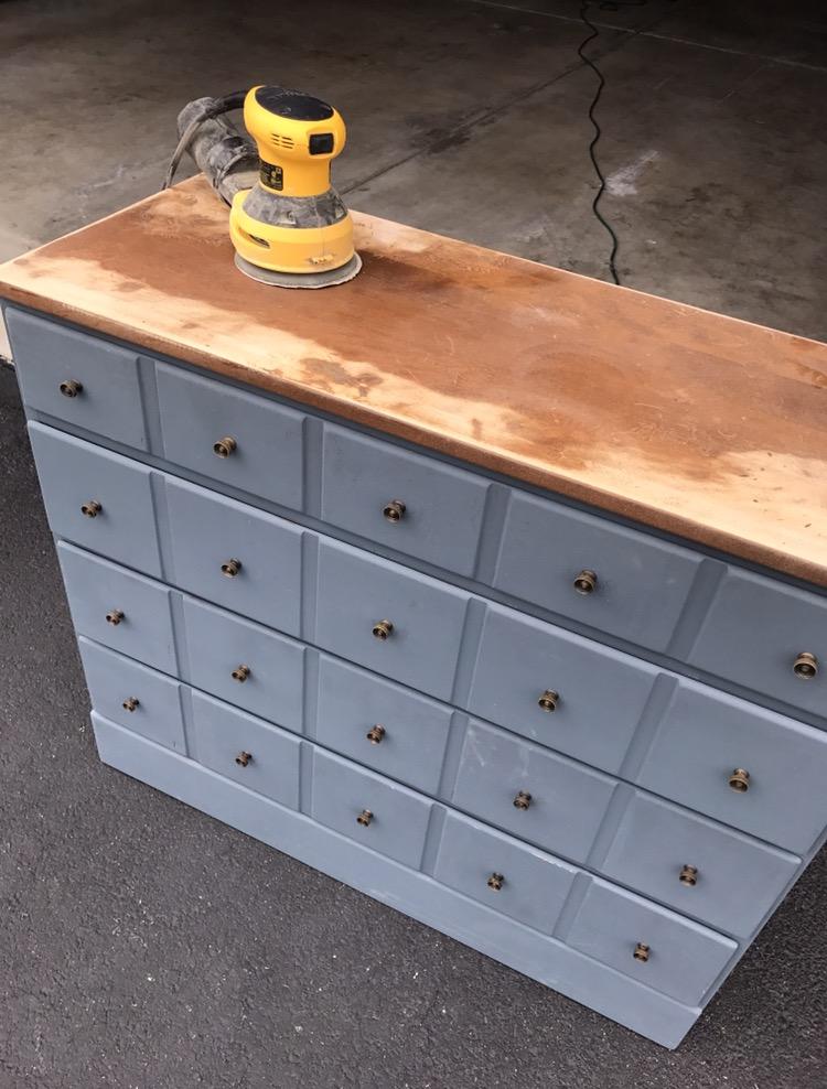 sanding top of dresser