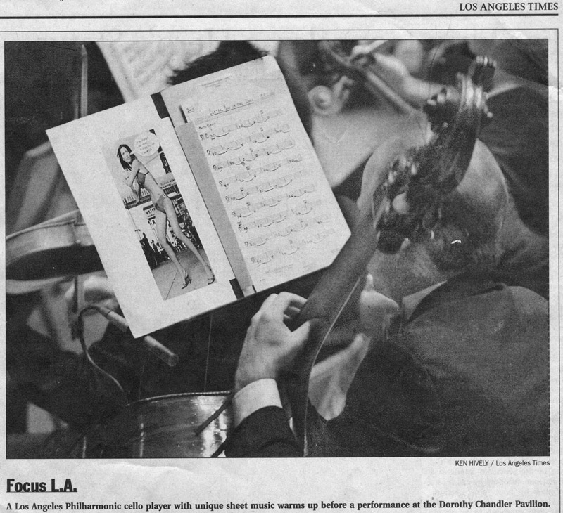 A Los Angeles Philharmonic cello player with unique sheet music warms up before a performance at the Dorothy Chandler Pavilion