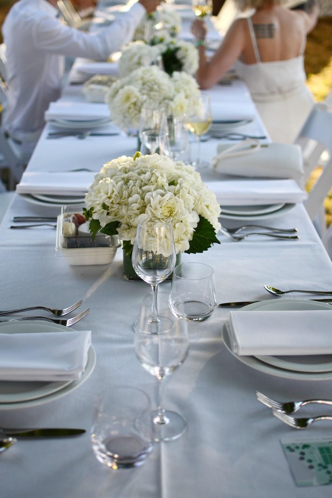 Diner en Blanc Vancouver aleesha harris floral arrangement table setup