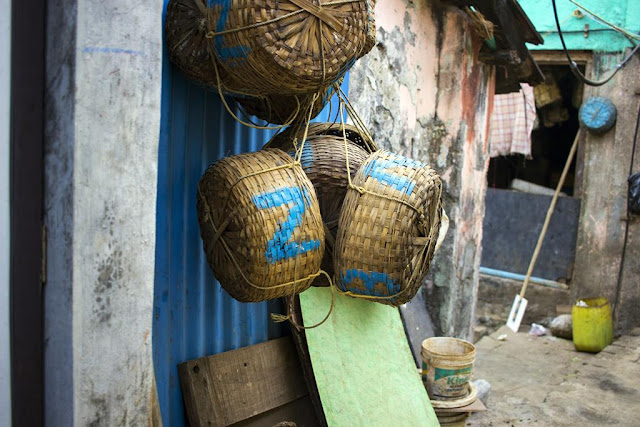 baskets, fish, fisherman, home, koliwada, worli, mumbai, india, streetphoto, street photography, oar, bucket,