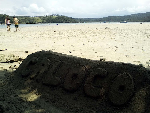 caloco white sand beach of tinambac camarines sur bicol and sand sculpture