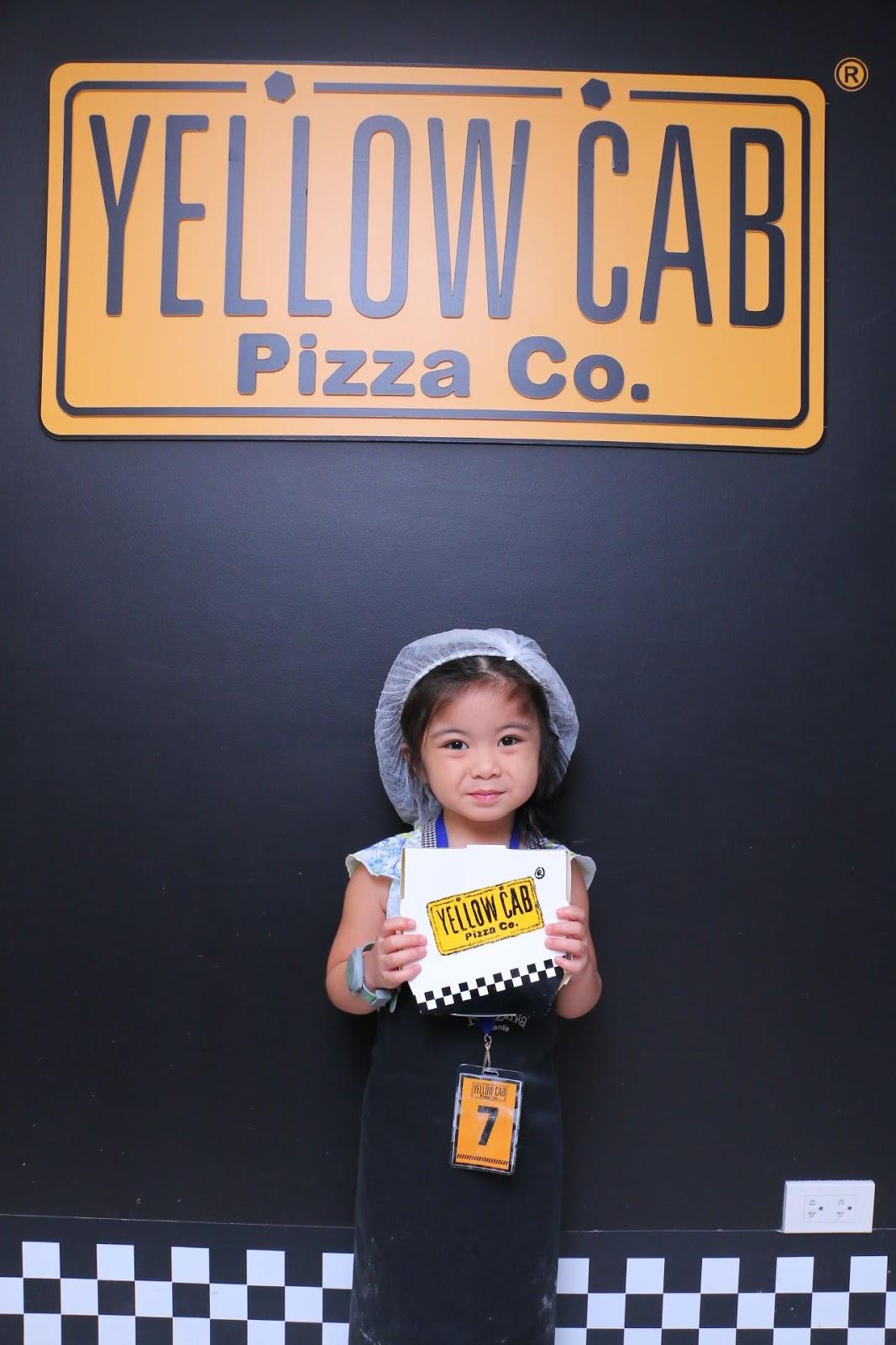 Chloe having Yellow Cab Pizza in KidZania Manila