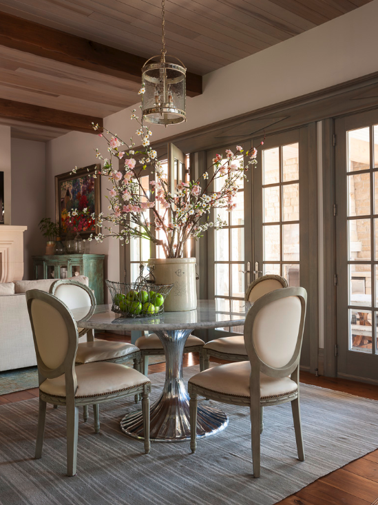 French country dining area with modern round table and Louis dining chairs. #frenchcountry #interiordesign #gustavian #nordicfrench