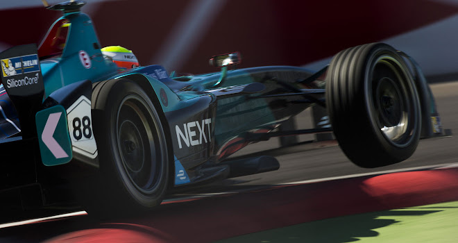 Formula E car clipping a corner