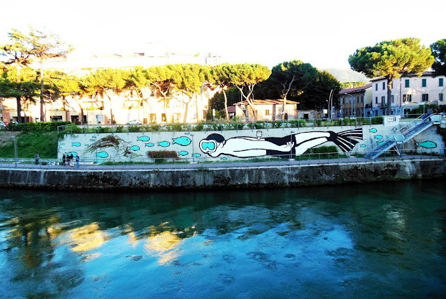"Italian Street Artist MP5 Paints a new mural entitled ""Playing Upstream"" in Terni, Italy. 3"