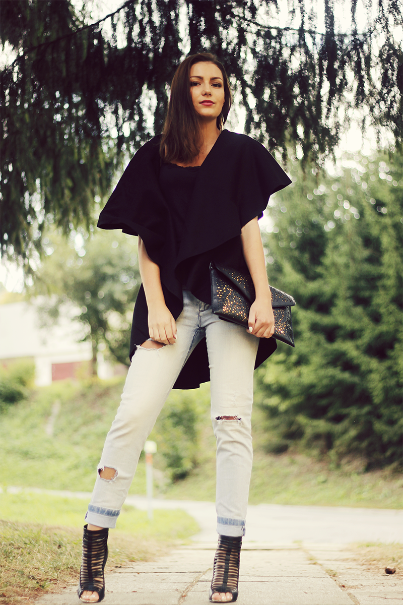 boyfriend jeans and black batwing cape