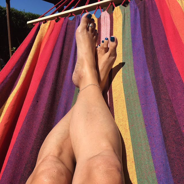 hammock with legs and blue sky above