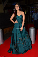 Raashi Khanna in Dark Green Sleeveless Strapless Deep neck Gown at 64th Jio Filmfare Awards South ~  Exclusive 036.JPG