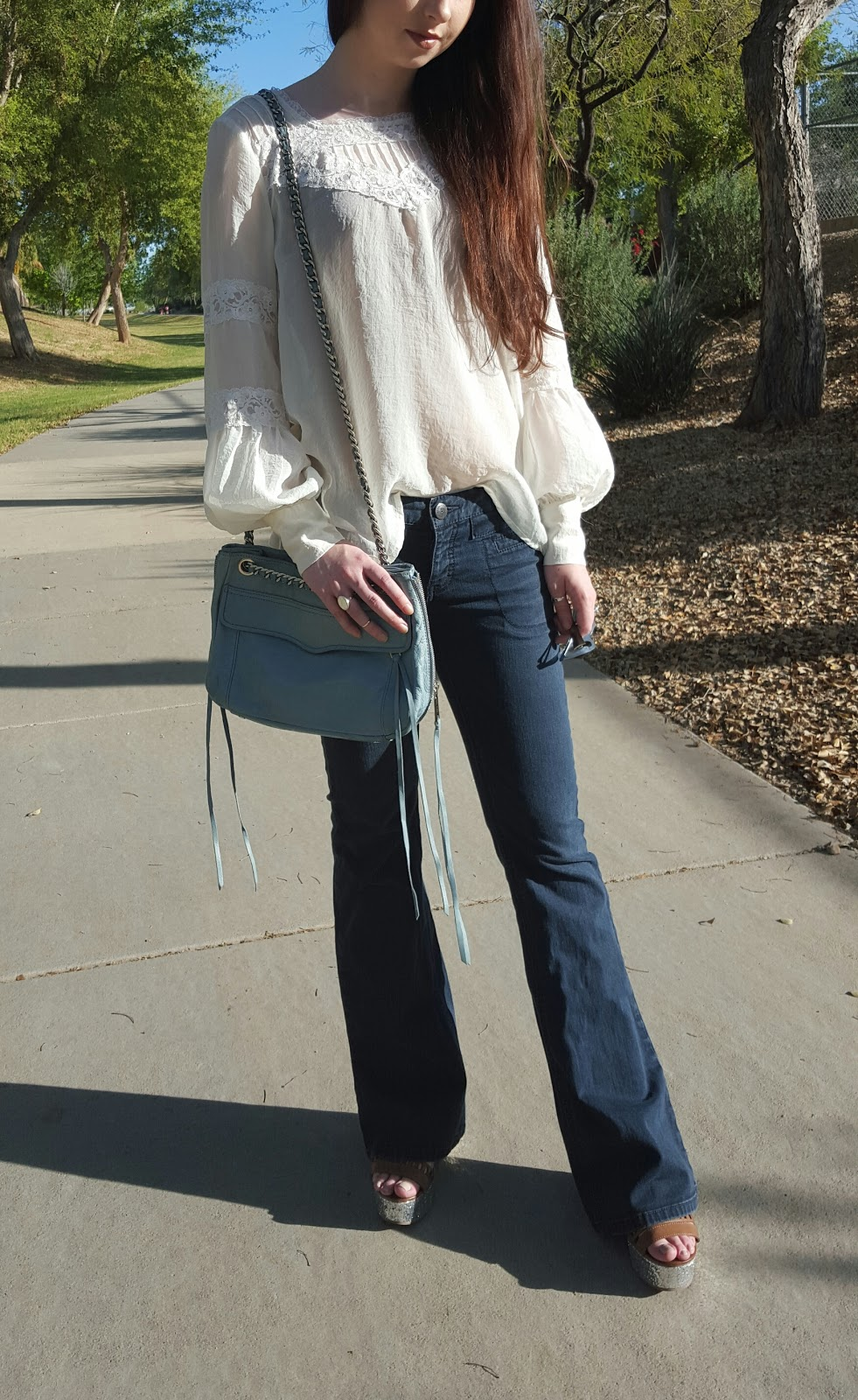 glam boho outfit for Spring with flare jeans and flowy top