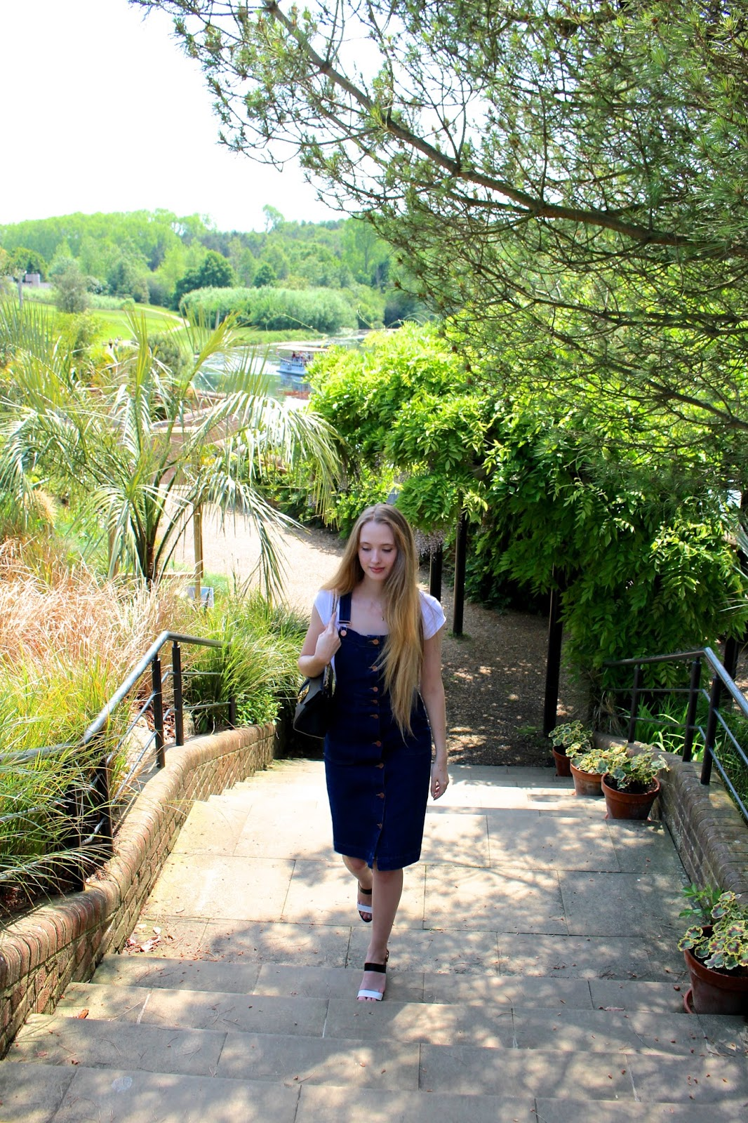 Blogger walking through the gardens of Leeds Castle