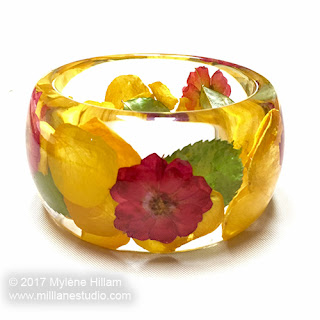 Roses, roses, roses. Ultra clear resin bangle filled with dried roses and rose petals.