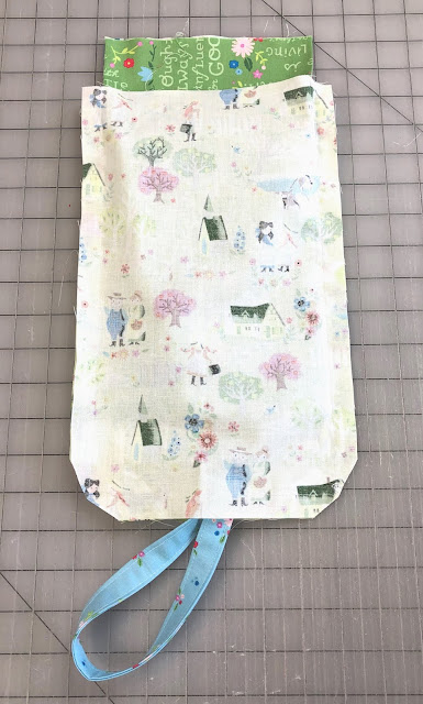 How to Sew a Small Sling Bag for Kids, a tutorial featured by top US sewing blog, Ameroonie Designs: insert exterior into lining