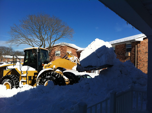The snow was eventually piled up to the second floor level.