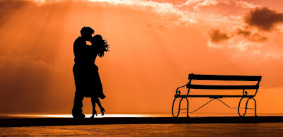 couple standing in sunset