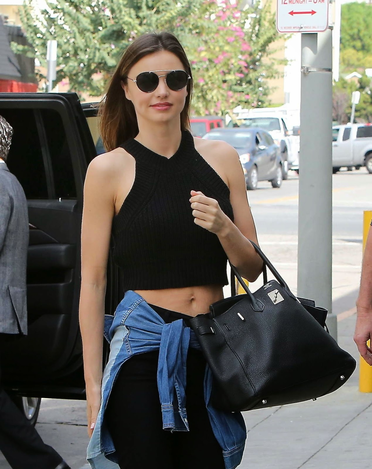 Miranda Kerr in a cropped top and jeans in Santa Monica