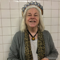 rider wears crown at 23rd Street subway station in NYC