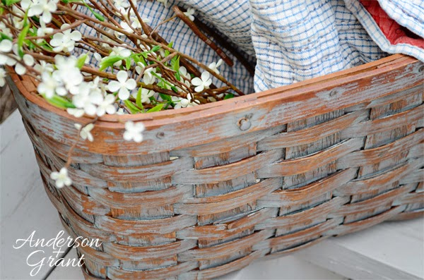 Refurbished picnic basket made into a decorative storage basket | www.andersonandgrant.com