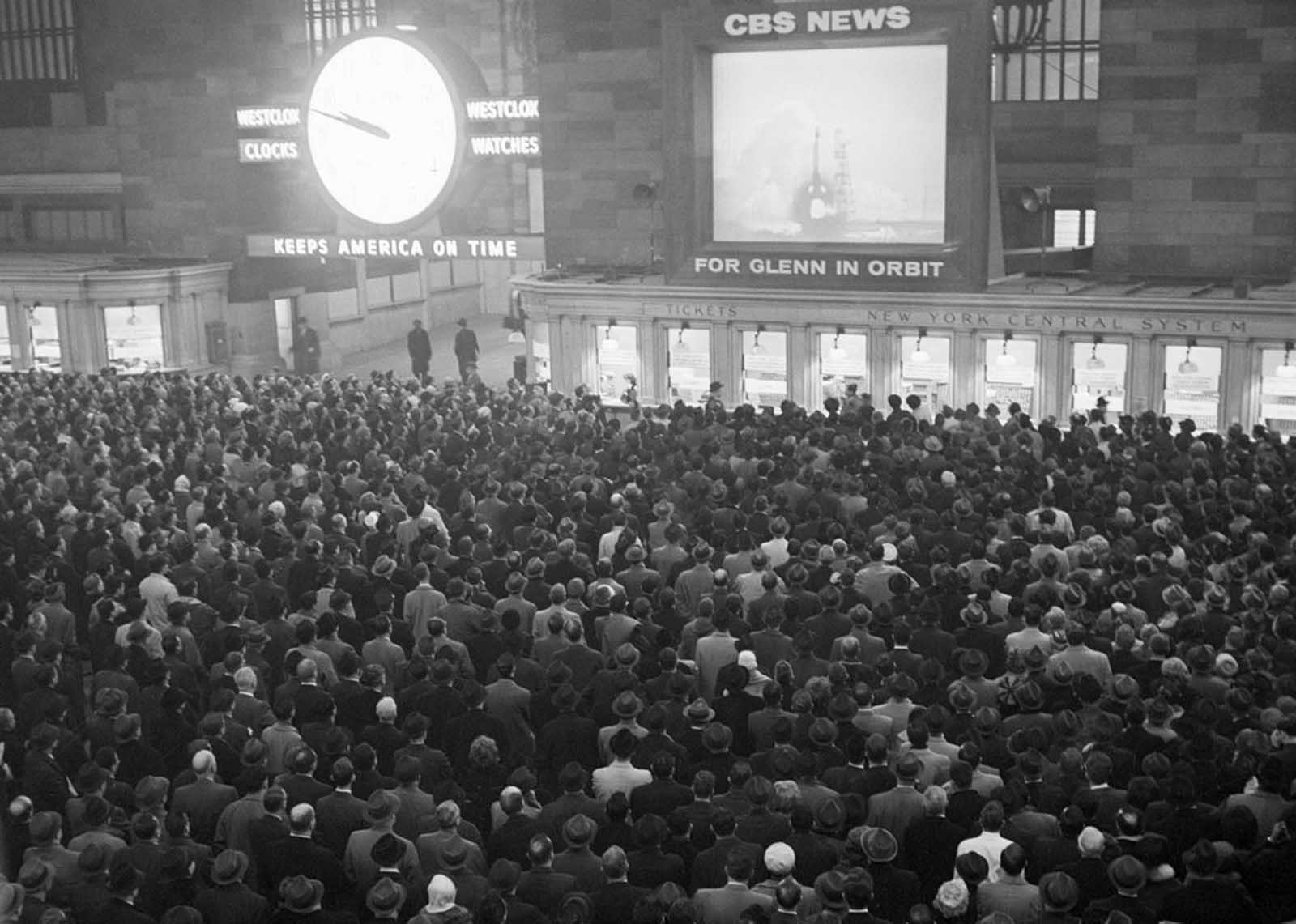 Some 5,000 workers watch the launching of astronaut John H, Glenn Jr. into orbit around the world on a huge television screen in Grand Central Terminal, on February 20, 1962.