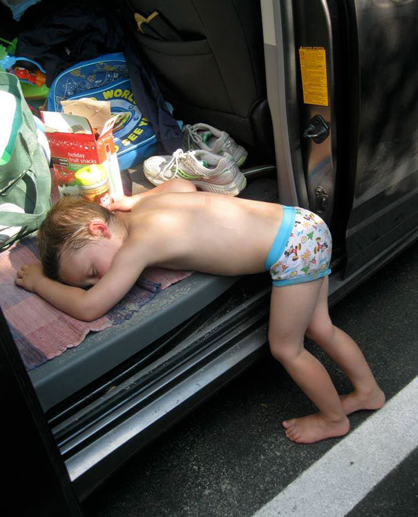 15+ Hilarious Pics That Prove Kids Can Sleep Anywhere - Napping On The Van's Floor