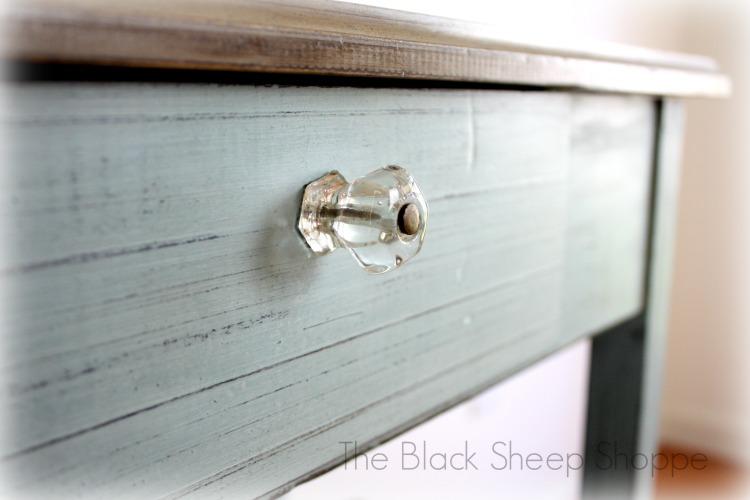 Original glass knob on writing desk.
