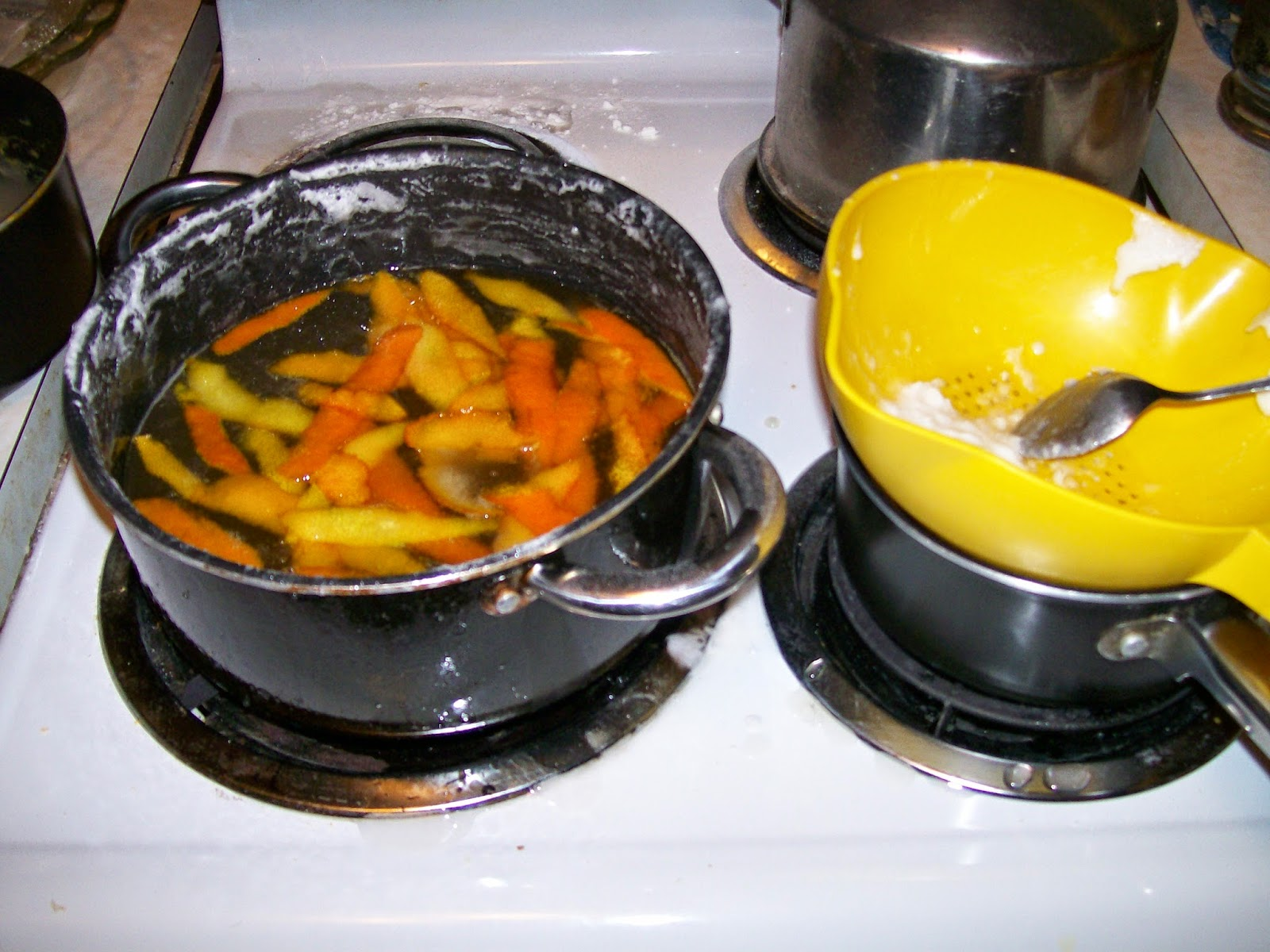 Orange peel in clarified sugar syrup for making fruit ices.