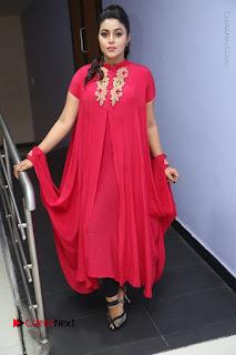 Actress Poorna Latest Stills in Red Dress at Rakshasi First Look Launch  0303.JPG