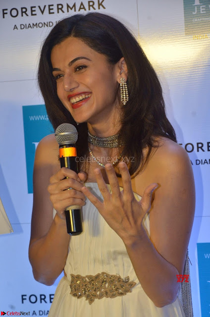 Tapsee Pannu looks Beautiful in White Sleeveless Gown Exclusive  Pics 01.jpg