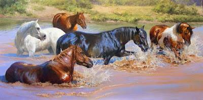 estampida de caballos en el agua